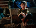boy-sitting-in-house-0265
